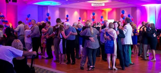 A full dance floor slow dancing to the golden oldies at a 50th Anniversary Party in Bentonville, Arkansas.
