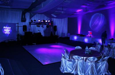 The Prom room is gorgeous as it glows brightly with the purple uplights surrounding the dance floor beside the 10 foot video screen and the massive array of lights and special effects in Fort Smith, Arkansas.