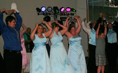 The Bridal party dressed in baby blue lead the entire group at the reception in Fort Smith, Arkansas, in the YMCA.