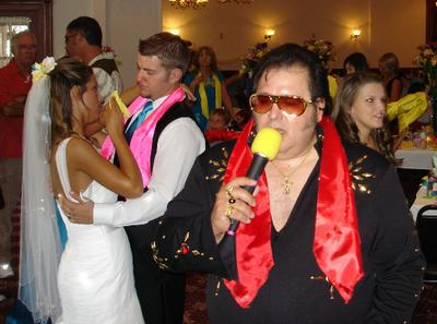 An Elvis impersonator showed up to sing karaoke at this wedding reception in Eureka Springs, Arkansas.