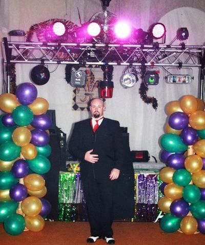 The DJ, Sean Hearn, sports his tux and black and white ganster spats in front of the huge display of lights and special effects ready for the High School Prom Students to come and dance.