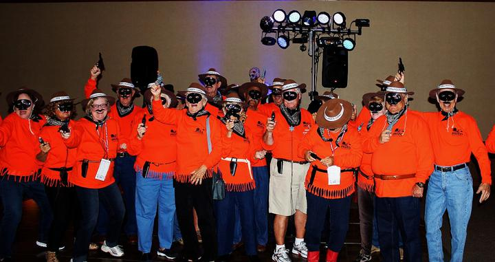 This year, there was a group that dressed up the same in orange shirts, fame mustaches and western hats at the Minnis In The Ozarks' Halloween party.