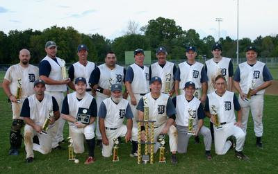 This is a team photo of the 2007 MSBL Men's Baseball team, the Tigers after winning the championship that season. Sean Hearn was the starting catcher for the Championship Tiger's squad.