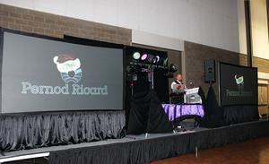 The stage boasts not one, but two large video screens in front of the employees of Pernod Ricard (Hirem Walker) and their Christmas Party in the Fort Smith Convention Center.