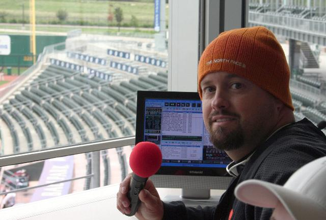 Sean Hearn, owner and DJ for Music in Motion as the public address announcer for the Arkansas Naturals Minor League baseball team.