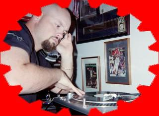 Mixologist and DJ Sean Hearn working the vinyl on the old but reliable SL-1200 Technics direct-drive turntable; no doubt creating another remix or medley to drop in the club and entice his dancers at the party out and onto the floor.