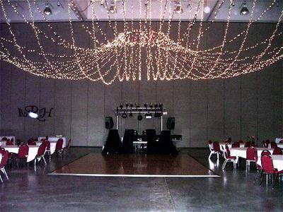 DJ Sean Hearn's sound and lights set up at a wedding reception at the Fort Smith Arkansas Convention Center which includes a 10 foot truss full of Martin, Chauvet and American DJ lights and 2 JBL Eon Power Speakers.