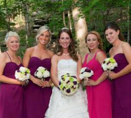 Alicia Weber in her wedding dress surrounded by her bridesmaids.