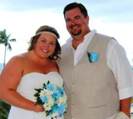 Bryan Brown and his new wife with a gorgeous blue flower bouquet on the beach during their honeymoon.