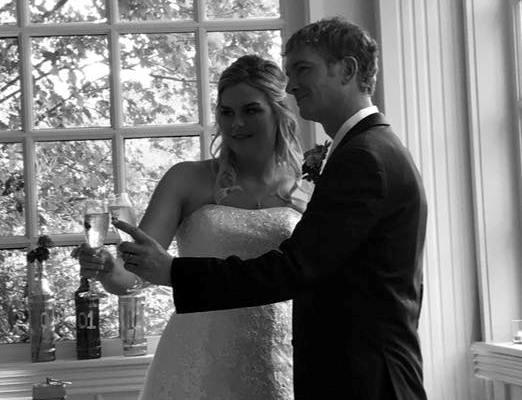 A black and white photo of Mandy McClinton two-stepping with her new husband at the Crescent Hotel.