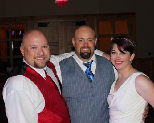 Mykie Lawson with her entertainer Sean Hearn and her new husband.
